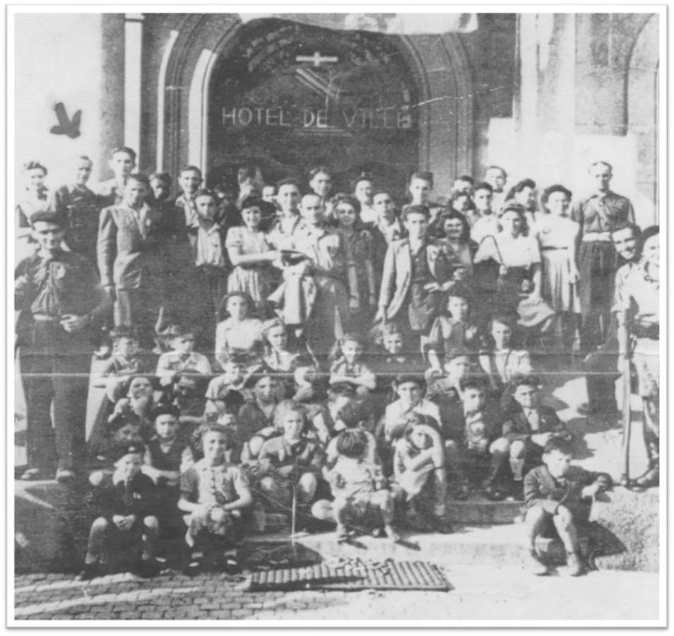 Koenig children amongst crowd outside Annemasse Town Hall